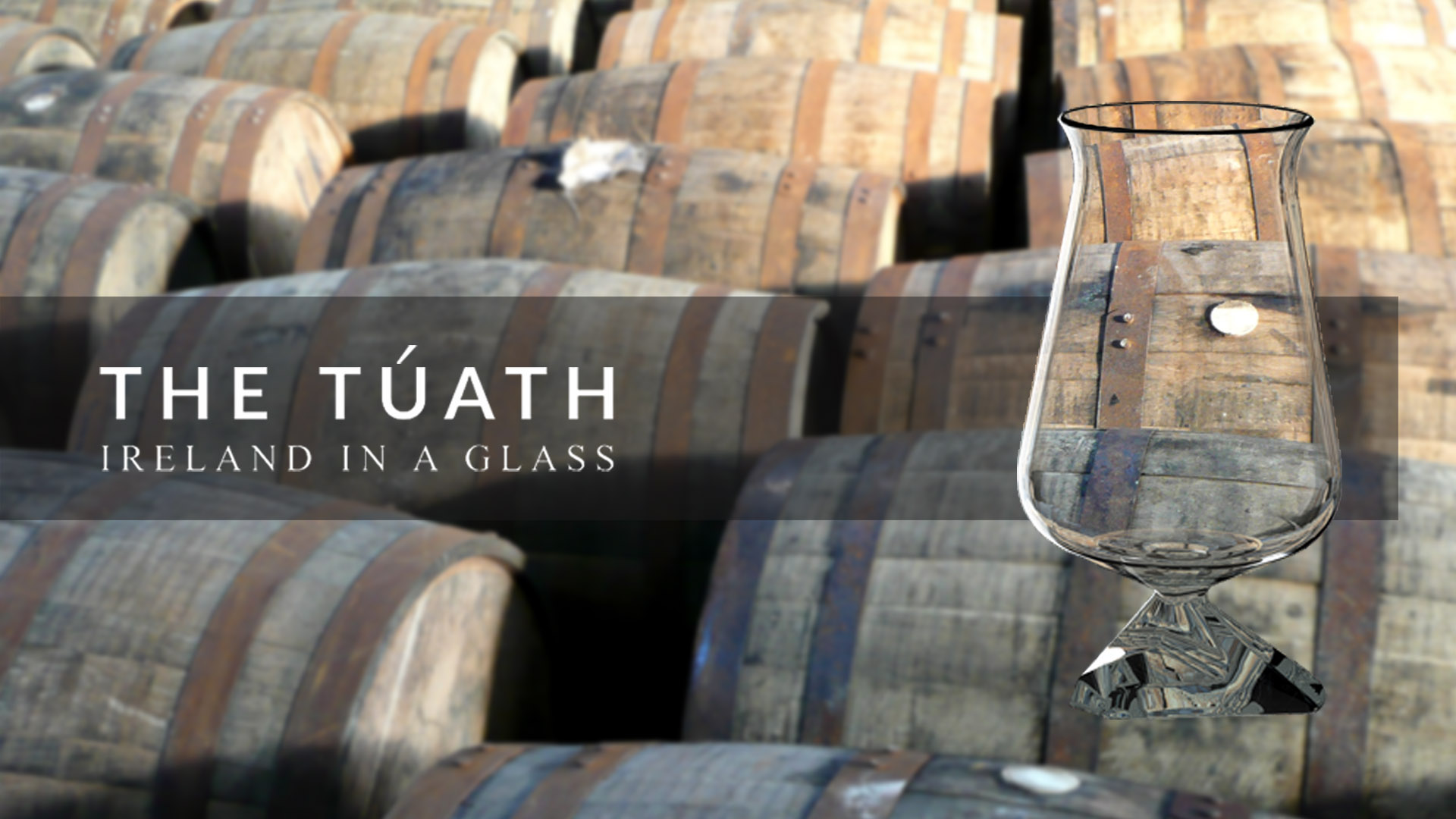 the tuath glass with barrels background