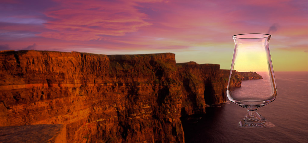 tuath glass over cliffs sunset